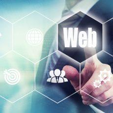 Businessman pressing an Web concept button.